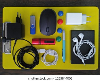 Computer peripheral and entertainment accessories on yellow board