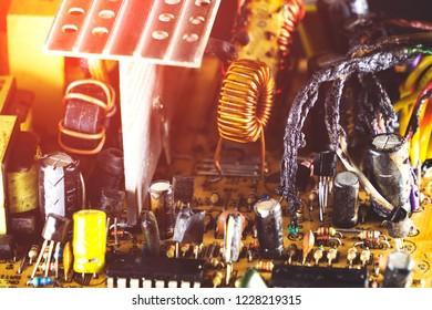computer power supply in smoke on a black background, broken computer equipment