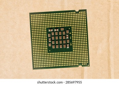 Computer processor chip (CPU) isolated on carton background