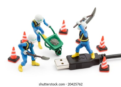 computer repair concept - usb cable repaired by workers isolated