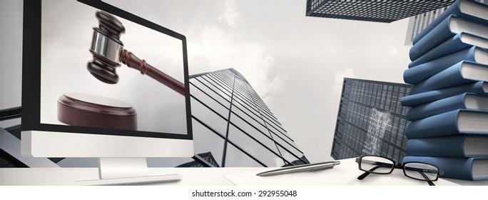Computer screen against gavel banging