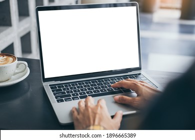 computer screen blank mockup.hand woman work using laptop with white background for advertising,contact business search information on desk at coffee shop.marketing and creative design