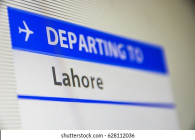 Computer screen close-up of status of flight departing to Lahore, Pakistan