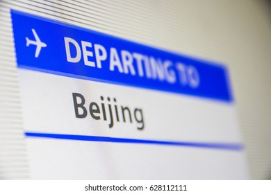 Computer screen close-up of status of flight departing to Beijing, China