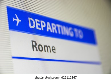 Computer screen close-up of status of flight departing to Rome, Italy