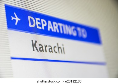Computer screen close-up of status of flight departing to Karachi, Pakistan