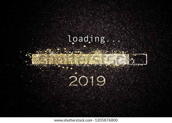 Computer screen with loading bar counting down for New Years Eve 2019 with sparkling glitter and copy space over black