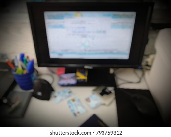 Computer screen and stationery Card scanner And ID cards put on the table, Registration, blurred photo
