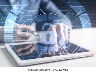 Computer security concept and information technology. Risk management and professional safeguarding of cyberspace. Virtual padlock blue hologram and human hands with tablet computer on background.