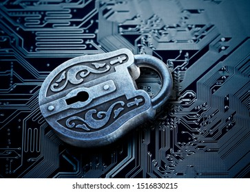 Computer security concept. Old mysterious padlock on computer circuit board