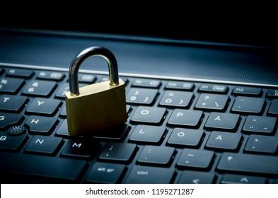 Computer security concept. Padlock on computer keyboard. Selective focus.