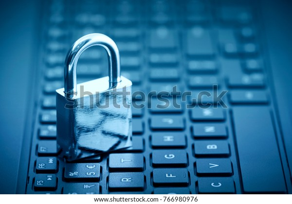 Computer security concept. Padlock on computer keyboard