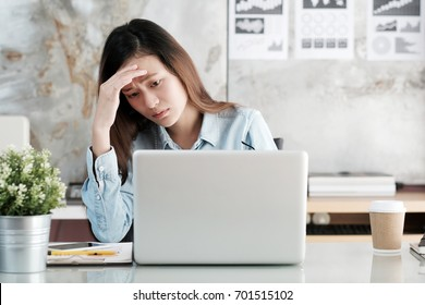 Computer stressed, Asian woman struggle while working with laptop, Frustrated asia female at office desk, Depressed university student girl while study online, People struggle with technology