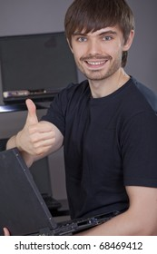 computer support - happy male technician showing thumb up