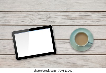 Computer Tablet with Blank Screen on Deck Table by Coffee or Tea cup