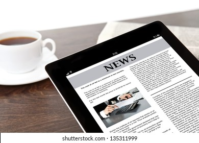 computer tablet with business news on screen on a table at a businessman in office