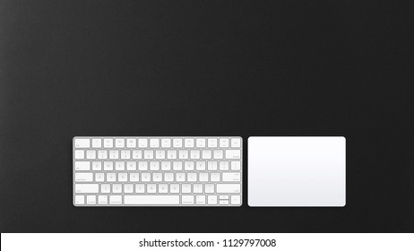 Computer track-pad and keypad on a dark background