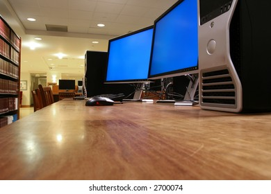 a computer with two monitors; the monitors are turned on