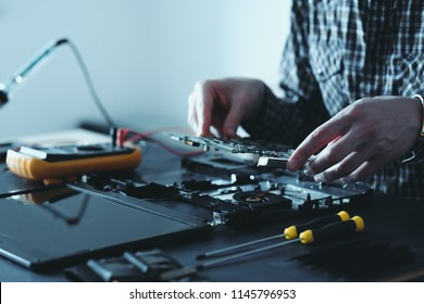 computer upgrade. technology development. microelectronics scientific innovation concept. engineer disassembling laptop