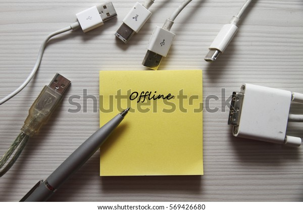 Computer USB cable with pen, note and text Offline.
