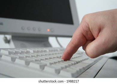 Computer worker presses button to begin working