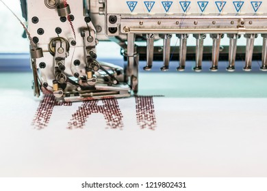 Computerized embroidery machines. sewing machine on blurred background. textile workshop. closeup