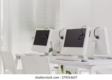 Computers and headsets in empty office