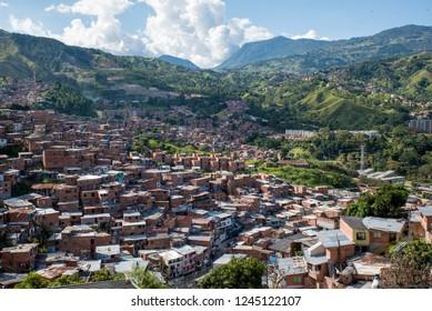 Comuna or slum / slums in Medellin  Colombia. Comuna 13 is known for escalators between streets. Colourful buildings. Favela.
