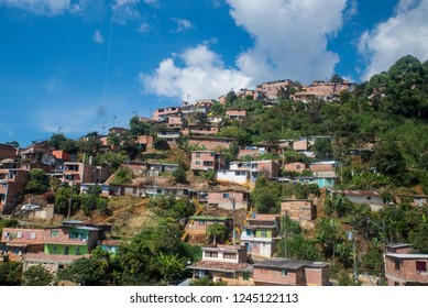 Comuna or slum / slums in Medellin  Colombia. Comuna 13 is known for escalators between streets. Colourful buildings. Favela.