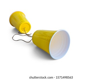 Comunication Yellow Plastic cup with string isolated on white