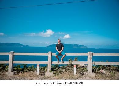 Con Dao,  VIETNAM - FEB 22, 2019: the man walk on beach at Con Dao island , Viet Nam