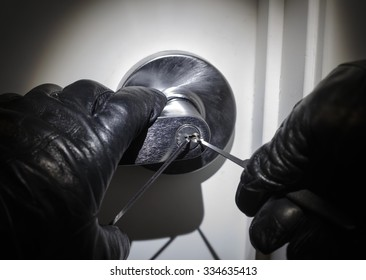 Con Man Picking Lock with Black Leather Gloves at Night