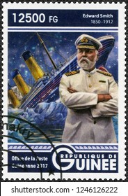 CONAKRY, GUINEA - MAY 22, 2017: A stamp printed in Republic of Guinea shows Titanic and Edward Smith (1850-1912) captain of RMS Titanic, 2017
