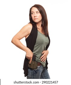 CONCEALED CARRY AND PERSONAL DEFENSE | Woman Practicing Gun Safety with hand on gun in holster, looking over her shoulder | Female shooter holding handgun against white background.