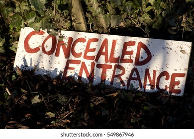 Concealed entrance hand written sign.
