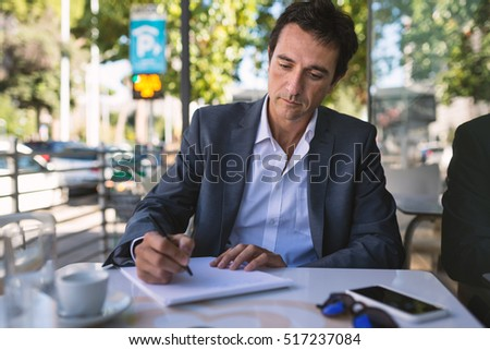 Concentrate Middle Age Businessman Portrait Writing Stock Photo  Concentrate Middle Age Businessman Portrait Writing An Essay Outdoors In  Rome Italy
