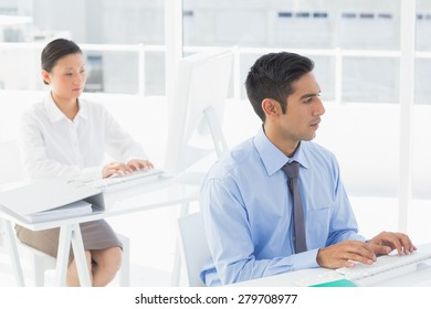 Concentrate work team using computer in office