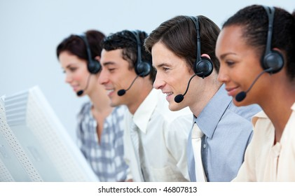 Concentrated business people using headset in a call center