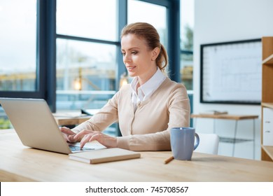 Concentrated businesswoman working with a laptop