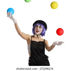 Concentrated juggler clown playing with colorful ball