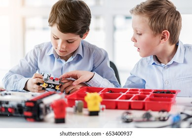 Concentrated male children keeping lego