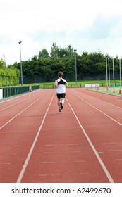 Concentrated male sprinter training in a stadium