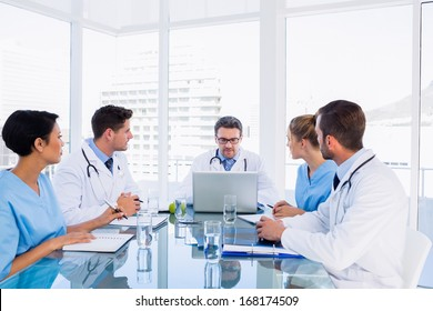 Concentrated medical team around desk in the office