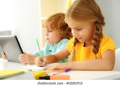 concentrated modern children studying indoors