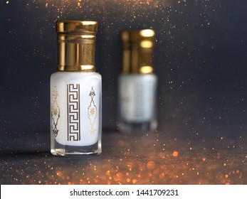 Concentrated perfume in a mini bottle on the black background.