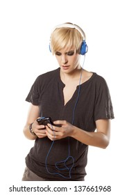concentrated pretty blonde with short hair choosing a favorite song on her phone