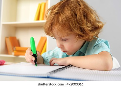 concentrated pupil sitting with marker