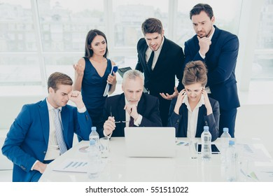 Concentrated smart business people working on difficult financial project