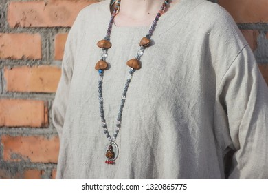 Concentrated woman praying wearing rosary beads. Close up