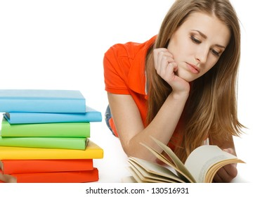 Concentrated woman reading the book lying on the floor, over white background